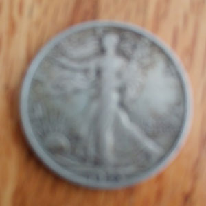 An unacceptable blurry coin photograph. This is caused by a shaky photographer, an out-of-focus lens, or both.